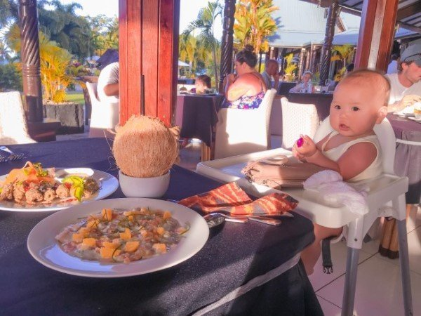 Baby on high chair with delicious food at Sheraton Samoa Beach Resort