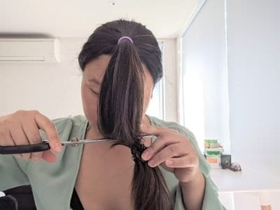 use a hair band to mark where you want to cut your hair