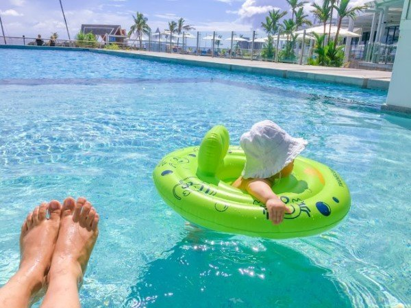 Baby with swimming ring in infinity pool at Taumeasina-Island-Resort-Infinity-Pool-Apia-Samoa
