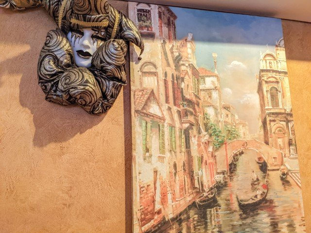 Masquerade mask and Venice painting at Italian restaurant