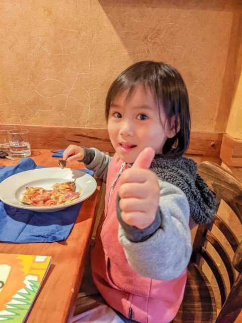 preschooler thumbs up for pizza at Caffe Centrale Italian Restaurant in Hamilton